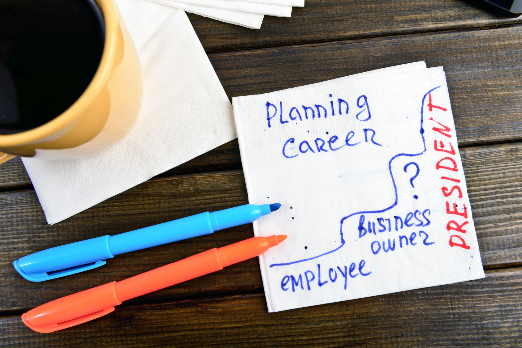 planning career think positive –  handwriting on a napkin
