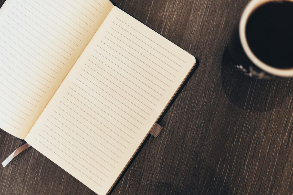 journal with coffee